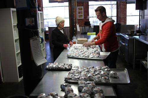 Moorman and Foss organize the sandwiches.