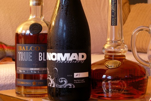 My bottle of Nomad Batch #1, posing with two American whiskeys Ive been enjoying lately