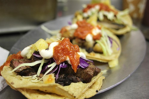 Skirt steak tacos, with Genesis Growers cabbage and Mexican Crema Suprema.