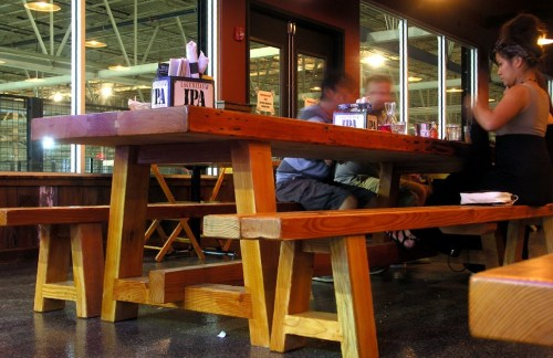 The benches arent attached to the tables, which makes it easier for larger humans to get situated comfortably.