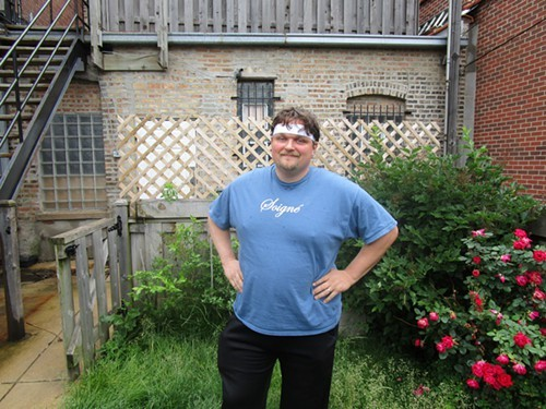 Tim Cottini in the backyard that will soon be a steakhouses patio.