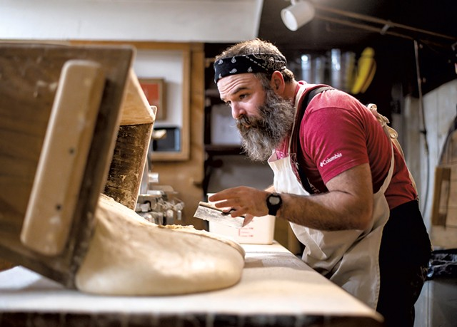 Trent Cooper is preparing to divide and shape naturally leavened bread into bâtards - GLENN RUSSELL