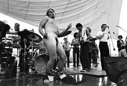 When it got too wet to safely play on the stage, some non-musicians took over the entertainment duties. - TIM FULLER