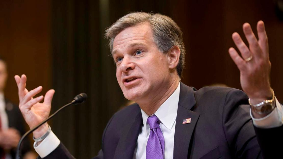 FBI Director Wray breaks with Attorney General Barr over whether the government 'spied' on Trump campaign