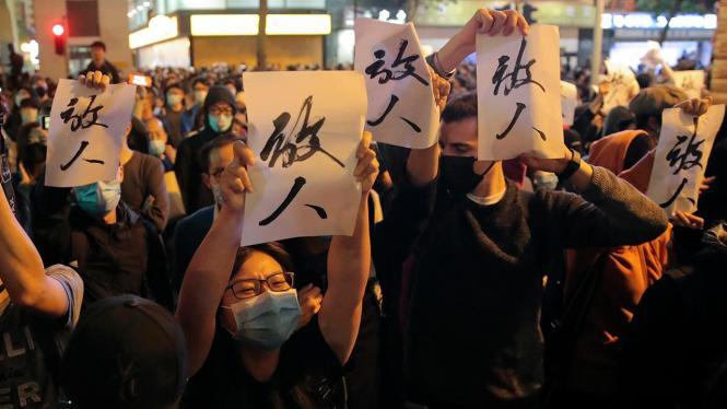 Pro-democracy candidates in Hong Kong claim landslide win at polls