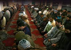Kashmiri men offer Friday prayers at the Ahl-e-hadith mosque in Gawkadal, Srinagar.