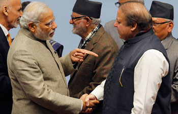 "Prime Minister <a href=""http://indiatoday.intoday.in/people/narendra-modi/17737.html"">Narendra Modi</a> shakes hands with Pakistan Prime Minister Nawaz Sharif during the closing session of 18th SAARC summit in Kathmandu. Photo: Reuters."
