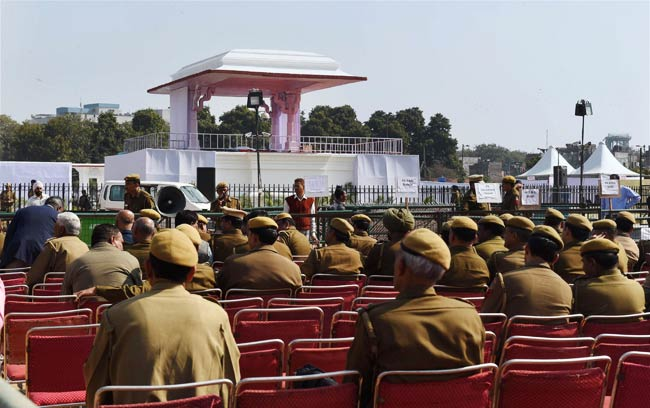Policemen at the venue of the oath-taking ceremony of Arvind Kejriwal as Delhi Chief Minister, at Ramlila Maidan in New Delhi on Friday. Photo: PTI.