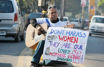 A man plays the guitar during a protest against the Dec 16 Delhi gangrape.