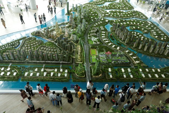 Prospects look at a model of the development at the Country Gardens' Forest City showroom in Johor Baru February 21, 2017. — Reuters pic
