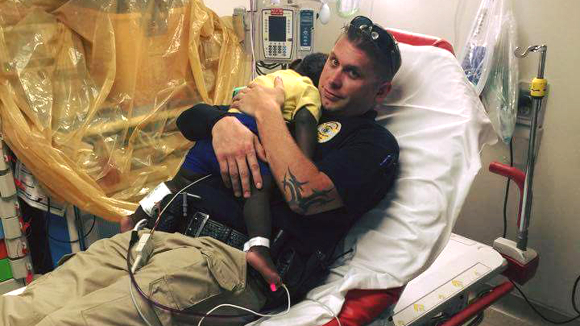 Police Officer Comforts Toddler Alone In The Hospital