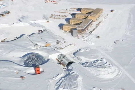 In this aerial view, the new Amundsen-Scott South Pole Station is shown (at upper right) along with its predecessor (lower left), which has been in operation for over 50 years.