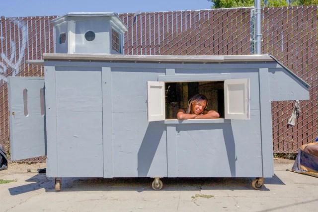 A woman is seen in a shelter built by California artist Gregory Kloen.