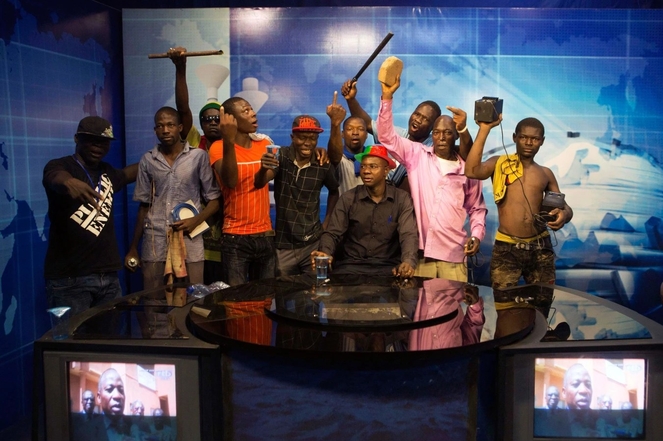 Image: Anti-government protesters take over the state TV podium in Ouagadougou