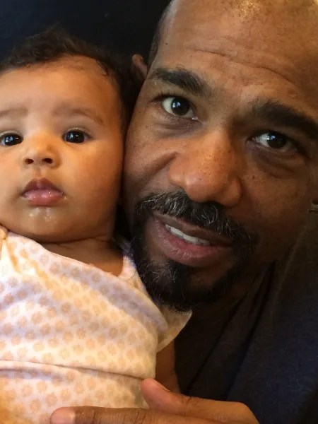 Actor Mike Beach defended his wife after she was criticized for posting a photo of her breast-feeding their daughter while doing her business (or trying to) on the potty.