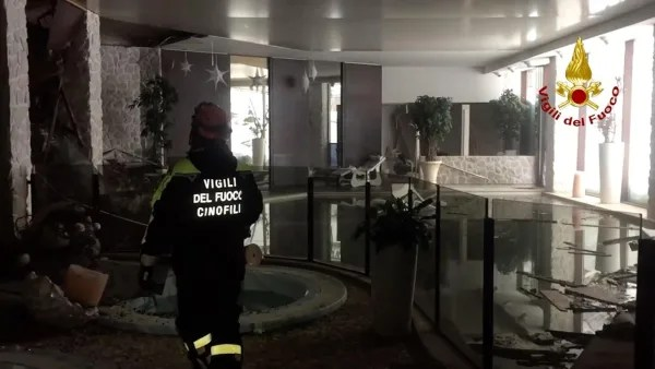 Image: An Italian firefighter walks inside the Hotel Rigopiano after an avalanche