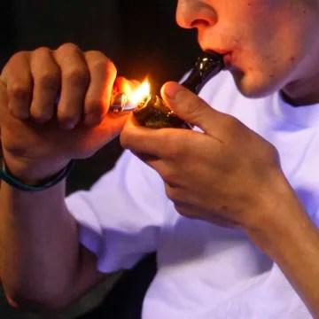 Image: Russell Diercks smokes marijuana inside of Frankie Sports Bar and Grill in Olympia