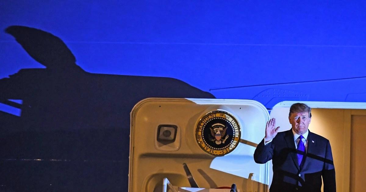 Trump lands in Vietnam for North Korea summit as shadow of