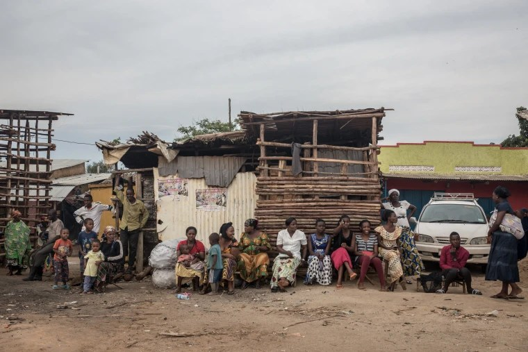 Image: Women gather to sit and chat in Nakivale refugee settlement in southwest Uganda. More than 100,000 refugees live there, according to the Ugandan government.