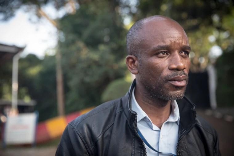 Image: Gratien Zimy Ntezimisi, a refugee whistleblower, standing outside UNHCR's headquarters in Kampala, Uganda, in January 2019.