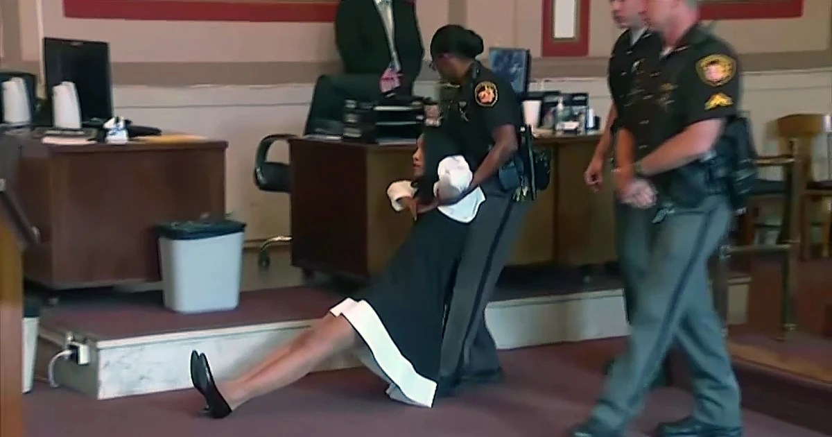 Courtroom chaos Video shows judge dragged away after her