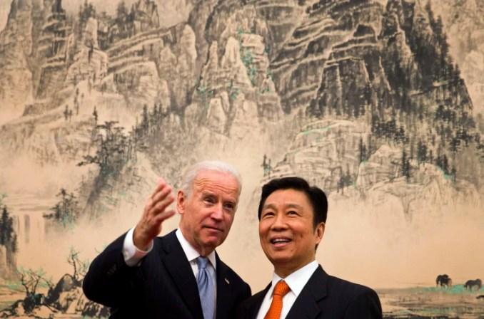 IMage: Vice President Joe Biden speaks with Chinese Vice Premier Li Yuanchao before a lunch in Beijing on Dec. 5, 2013.