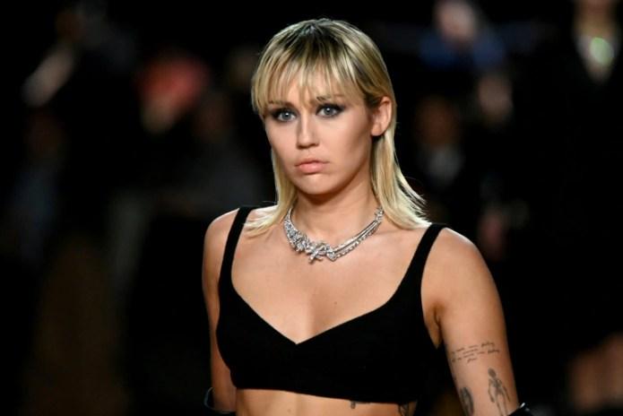 Image: Miley Cyrus walks the runway at New York Fashion Week on Feb. 12, 2020.