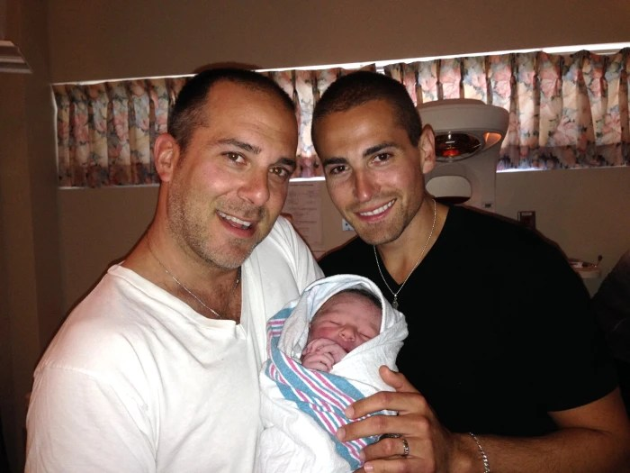 Viral photo with two dads meeting baby touches hearts ...