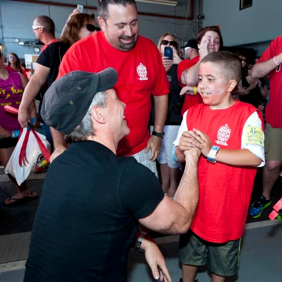 Mario Carpino meets Jon Bon Jovi, who made a surprise visit to Carpino's lemonade stand.