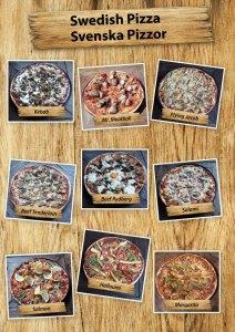 Svensk pizza serveras med pizzasallad på Cajutan i Bangkok