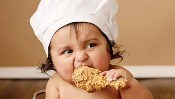 Image result for baby eating chicken