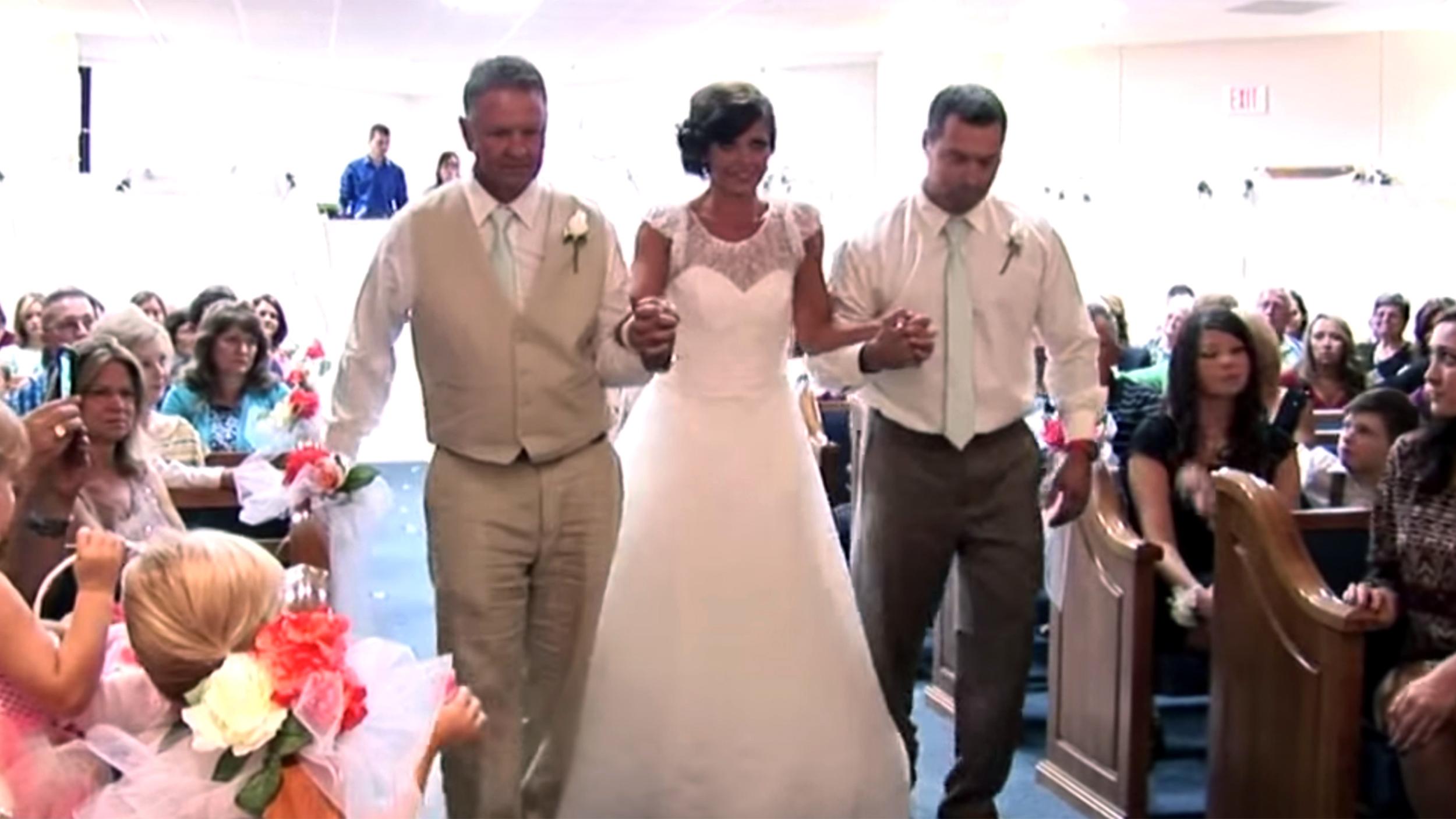 Louisiana bride paralyzed in car crash learns to walk down