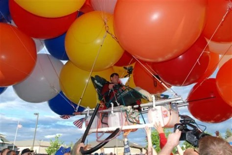 chair with balloons uw terrace chairs lawn balloonist achieves his dream us news weird