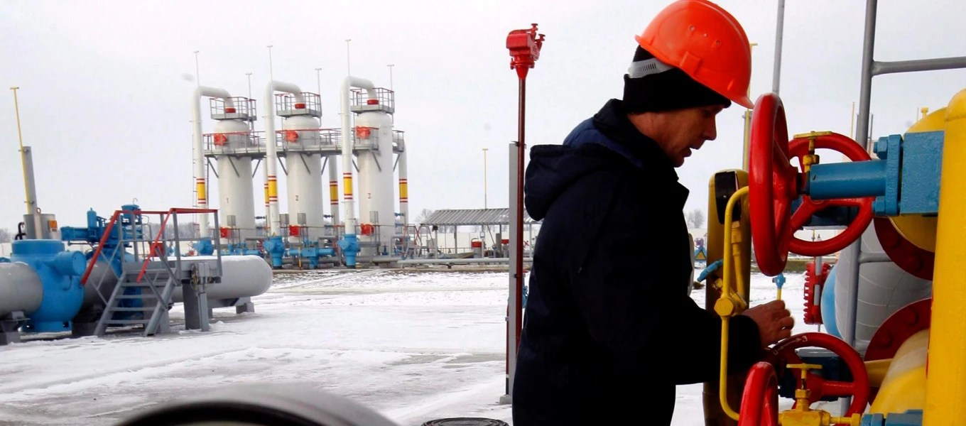 Image: A Ukrainian worker turns off a tap at the new gas-compressor station 'Bobrovnytska' in Mryn village