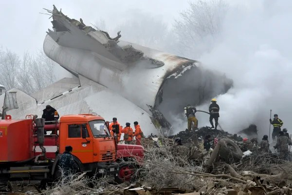 Image: Officials work in remains of a Boeing 747 cargo plane