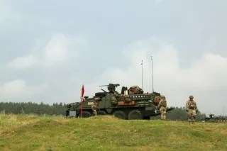 Image: U.S. Army soldiers move an armored Stryker vehicle into position during live-fire training.