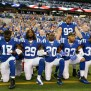 Nfl Players Lock Arms Kneel During National Anthem To