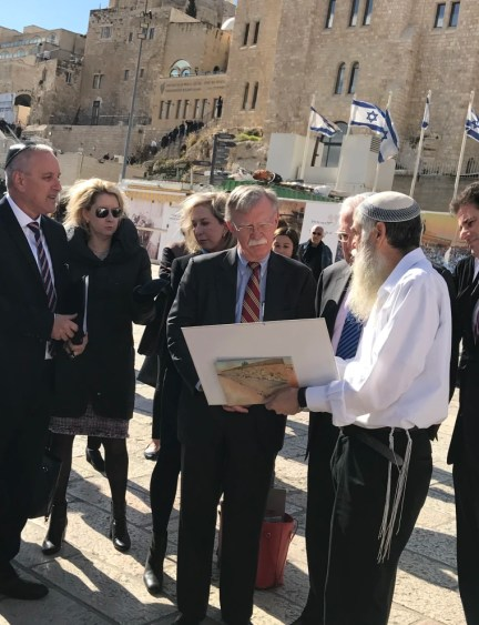 Image: John Bolton is shown around Jerusalem's Western Wall