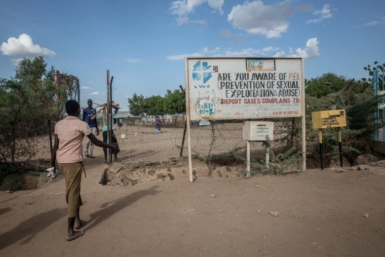 Image: A sign and comment box tells refugees to report sexual exploitation and abuse in the Kakuma refugee camp.