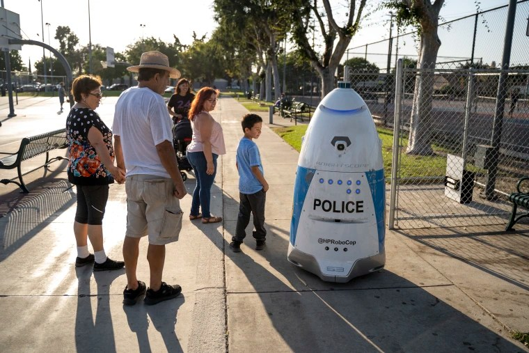 A group of people check out HP RoboCop in Salt Lake Park on Sept. 19, 2019.