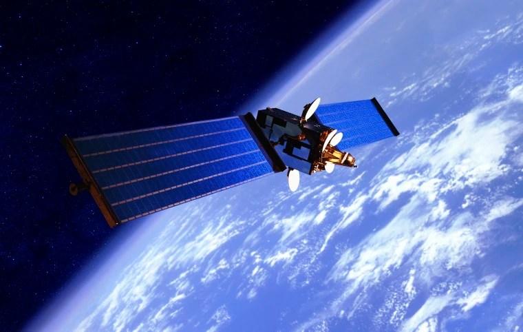 Image: A communication satellite orbits Earth.
