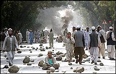 Afghan demonstrators block a road in protest against US soldiers killing civilians