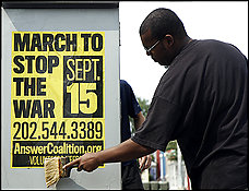 D.C. and Park Service officials are protesting signs, such as this one put up by Eugene Puryear, advertising ANSWER's Sept. 15 anti-war march.