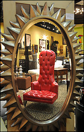 A high-back red leather chair at Nouveau.