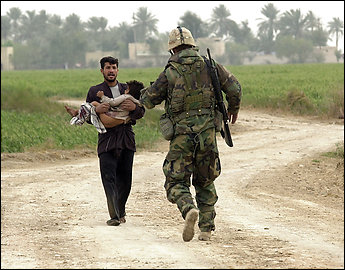 This photo and the next show the sequence of events leading up to the famous image of Dwyer carrying Sattar that made front pages worldwide in March 2003.