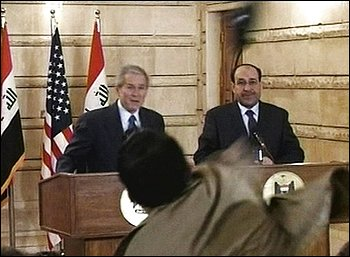 FILE - In this Dec. 14, 2008 file image made from APTN video, Iraqi reporter Muntadhar al-Zeidi throws a shoe at President George W. Bush during a news conference with Iraq Prime Minister Nouri al-Malik in Baghdad, Iraq. Al-Zeidi was released from a Baghdad prison Tuesday Sept. 15, 2009, his brother said. (AP Photo/APTN, File)