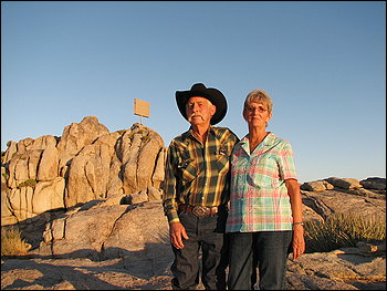 Henry and Wanda Sandoz are the unofficial caretakers of the Mojave cross, which is covered in a plywood box, near Cima, Calif.