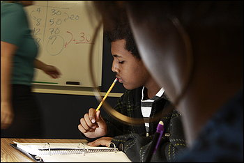 """Washington-Lee High School's Stephanie Nichols teaches Bazin Amaha, 14, and other students. """"Math is not a set of rules to memorize. It is problem-solving,"""" she said."""