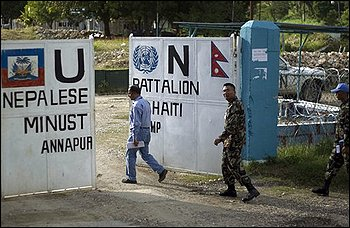 The head of Nepal's mission in Haiti, Lt. Col. Krishna, center, and Prakash Neupane, deputy chief of the MINUSTAH engineering section, left, enter Nepal's U.N. base in Mirebalais, Haiti, Sunday Oct. 31, 2010. A cholera outbreak that has killed more than 300 people in Haiti matches strains commonly found in South Asia, the U.S. Centers for Disease Control and Prevention said Monday, intensifying the scrutiny of a U.N. base that is home to recently arrived Nepalese peacekeepers, built on a tributary to the Artibonite River. (AP Photo/Ramon Espinosa)