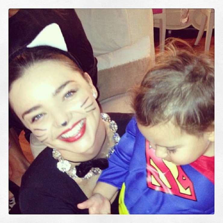 Miranda Kerr dressed as a cat while her son, Flynn Bloom, was Superman.<br /><br /> Source: Instagram user mirandakerr<br /><br />